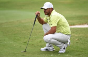 Aug 6, 2021; Memphis, Tennessee, USA; Brooks Koepka waits to putt on the fifth hole during the second round of the WGC FedEx St. Jude Invitational golf tournament at TPC Southwind. Mandatory Credit: Christopher Hanewinckel-USA TODAY Sports