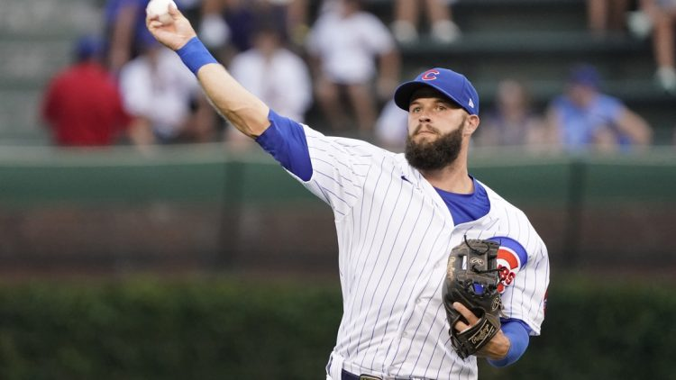 Aug 10, 2021; Chicago, Illinois, USA; Chicago Cubs second baseman David Bote (13) warms up before a game against the Milwaukee Brewers at Wrigley Field. Mandatory Credit: David Banks-USA TODAY Sports