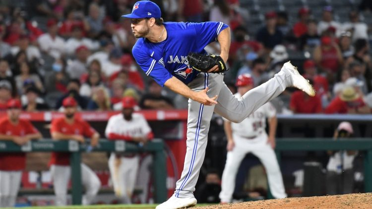 Aug 12, 2021; Anaheim, California, USA; Toronto Blue Jays relief pitcher Connor Overton (44) works the mound in the eighth inning against the Los Angeles Angels at Angel Stadium. Mandatory Credit: Richard Mackson-USA TODAY Sports