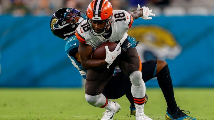 Aug 14, 2021; Jacksonville, Florida, USA;  Cleveland Browns wide receiver Davion Davis (18) is tackled by Jacksonville Jaguars safety Andre Cisco (38) in the second quarter at TIAA Bank Field. Mandatory Credit: Nathan Ray Seebeck-USA TODAY Sports