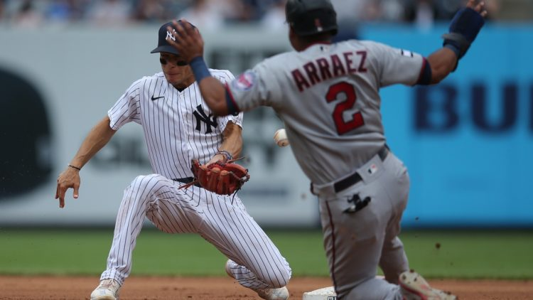 Aug 21, 2021; Bronx, New York, USA; Minnesota Twins third baseman Luis Arraez (2) steals second base as New York Yankees shortstop Andrew Velazquez (71) mishandles the throw during the fourth inning at Yankee Stadium. Mandatory Credit: Brad Penner-USA TODAY Sports