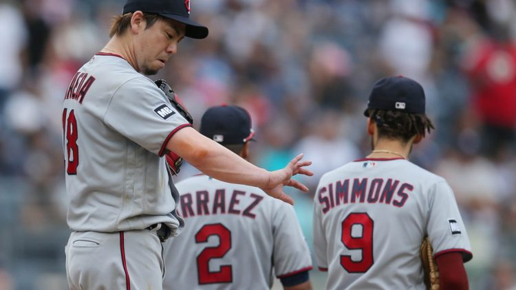 Aug 21, 2021; Bronx, New York, USA; Minnesota Twins starting pitcher Kenta Maeda (18) looks at his arm following a conference on the mound during the fifth inning against the New York Yankees at Yankee Stadium. Mandatory Credit: Brad Penner-USA TODAY Sports