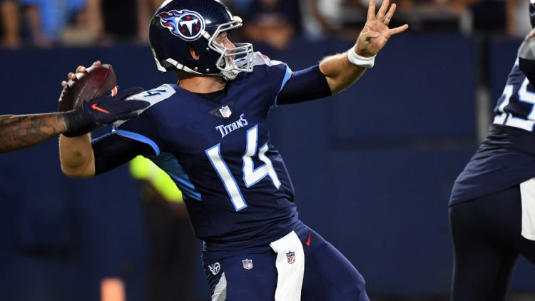 Aug 28, 2021; Nashville, TN, USA; Tennessee Titans quarterback Matt Barkley (14) is hit as he throws a pass against the Chicago Bears during the second half at Nissan Stadium. Mandatory Credit: Christopher Hanewinckel-USA TODAY Sports