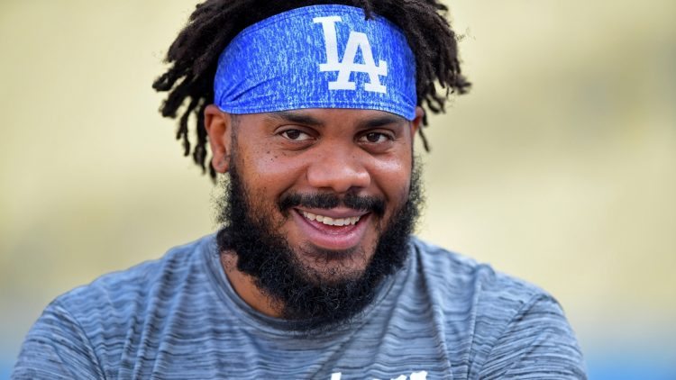Aug 30, 2021; Los Angeles, California, USA;  Los Angeles Dodgers relief pitcher Kenley Jansen (74) watches players take batting practice before the game against the Atlanta Braves at Dodger Stadium. Mandatory Credit: Jayne Kamin-Oncea-USA TODAY Sports