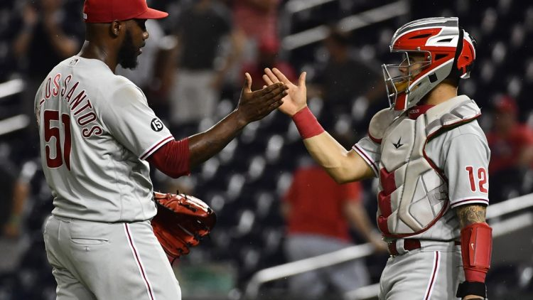 Aug 31, 2021; Washington, District of Columbia, USA; Philadelphia Phillies relief pitcher Enyel De Los Santos (51) is congratulated by catcher Rafael Marchan (12) after recording the final out against the Washington Nationals at Nationals Park. Mandatory Credit: Brad Mills-USA TODAY Sports