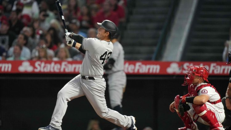 Aug 31, 2021; Anaheim, California, USA; New York Yankees first baseman Anthony Rizzo (48) follows through on a solo home run in the fourth inning as Los Angeles Angels catcher Max Stassi (33) watches at Angel Stadium. Mandatory Credit: Kirby Lee-USA TODAY Sports