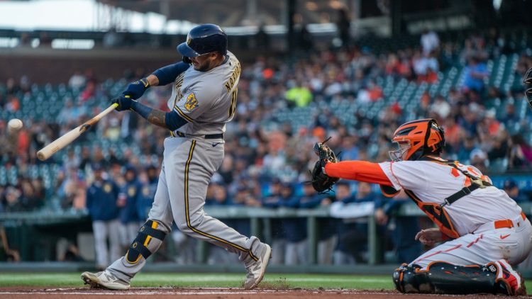 Sep 3, 2021; San Francisco, California, USA;  Milwaukee Brewers catcher Omar Narvaez (10) hits a RBI single against the San Francisco Giants during the first inning at Oracle Park. Mandatory Credit: Neville E. Guard-USA TODAY Sports