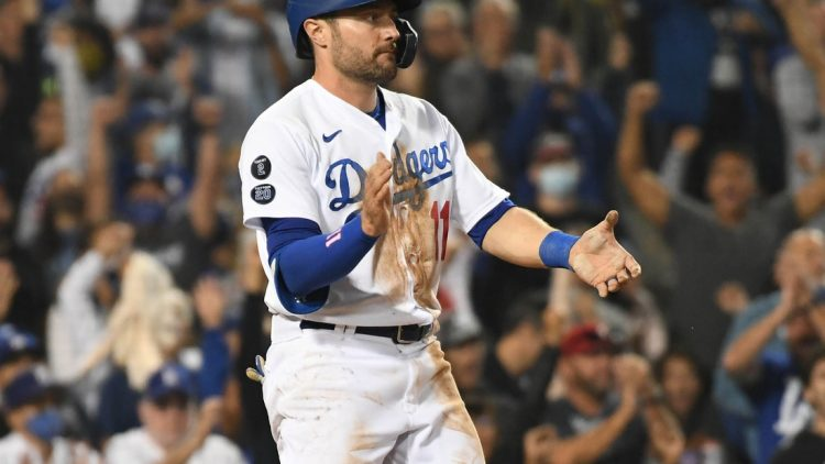 Aug 31, 2021; Los Angeles, California, USA; Los Angeles Dodgers left fielder AJ Pollock (11) reacts after scoring a run against the Atlanta Braves during the seventh inning at Dodger Stadium. Mandatory Credit: Richard Mackson-USA TODAY Sports