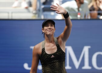 Sep 3, 2021; Flushing, NY, USA; Garbine Muguruza of Spain celebrates after recording match point against Victoria Azarenka of Belarus in a third round match on day five of the 2021 U.S. Open tennis tournament at USTA Billie Jean King National Tennis Center. Mandatory Credit: Jerry Lai-USA TODAY Sports