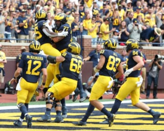 Michigan running back Blake Corum celebrates with teammates after his touchdown against Western Michigan during the first half in Ann Arbor on Saturday, Sept. 4, 2021.  Mich West