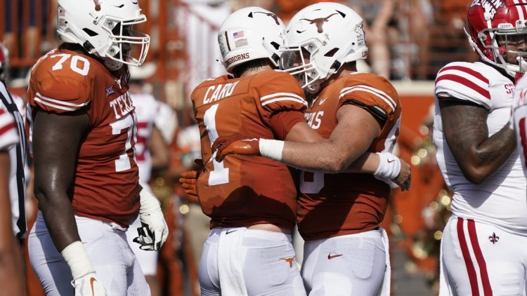 Sep 4, 2021; Austin, Texas, USA; Texas Longhorns tight end Cade Brewer (80) hugs quarterback Hudson Card (1) after catching a touchdown pass in the first half of the game against the Louisiana Ragin' Cajuns at Darrell K Royal-Texas Memorial Stadium. Mandatory Credit: Scott Wachter-USA TODAY Sports