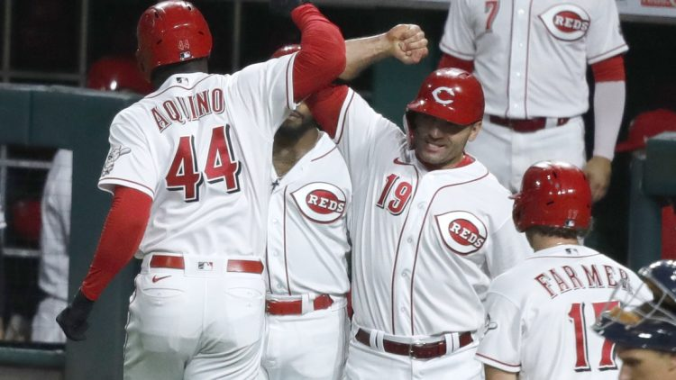 Sep 4, 2021; Cincinnati, Ohio, USA; Cincinnati Reds left fielder Aristides Aquino (44) reacts with first baseman Joey Votto (19) after hitting a three run home run against the Detroit Tigers during the third inning at Great American Ball Park. Mandatory Credit: David Kohl-USA TODAY Sports