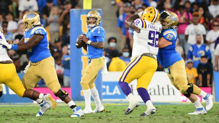Sep 4, 2021; Pasadena, California, USA; UCLA Bruins quarterback Dorian Thompson-Robinson (1) drops back to pass against the Louisiana State Tigers during the first half the at the Rose Bowl. Mandatory Credit: Gary A. Vasquez-USA TODAY Sports