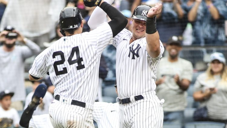Sep 5, 2021; Bronx, New York, USA;  New York Yankees catcher Gary Sanchez (24) is greeted by designated hitter Luke Voit (59) after hitting a grand slam home run in the second inning against the Baltimore Orioles at Yankee Stadium. Mandatory Credit: Wendell Cruz-USA TODAY Sports