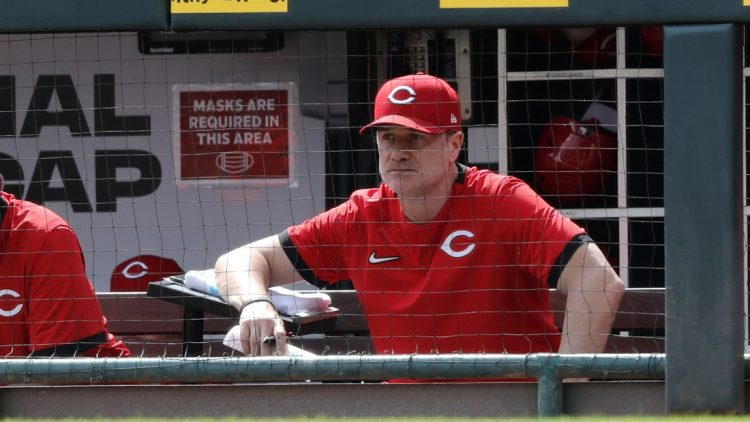 Sep 5, 2021; Cincinnati, Ohio, USA; Cincinnati Reds manager David Bell (25) watches from the dugout during a game against the Detroit Tigers at Great American Ball Park. Mandatory Credit: David Kohl-USA TODAY Sports