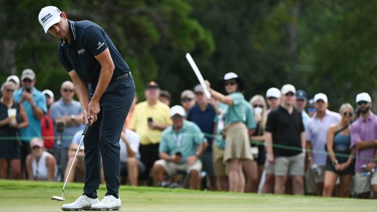 Sep 5, 2021; Atlanta, Georgia, USA; Patrick Cantlay putts on the 7th hole during the final round of the Tour Championship golf tournament. Mandatory Credit: Adam Hagy-USA TODAY Sports