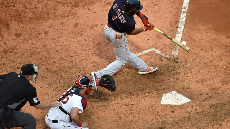 Sep 5, 2021; Boston, Massachusetts, USA;  Cleveland Indians shortstop Amed Rosario (1) hits an RBI single during the ninth inning against the Boston Red Sox at Fenway Park. Mandatory Credit: Bob DeChiara-USA TODAY Sports