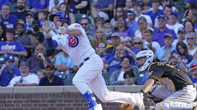 Sep 5, 2021; Chicago, Illinois, USA; Chicago Cubs first baseman Frank Schwindel (18) hits a grand slam home run against the Pittsburgh Pirates during the seventh inning at Wrigley Field. Mandatory Credit: David Banks-USA TODAY Sports