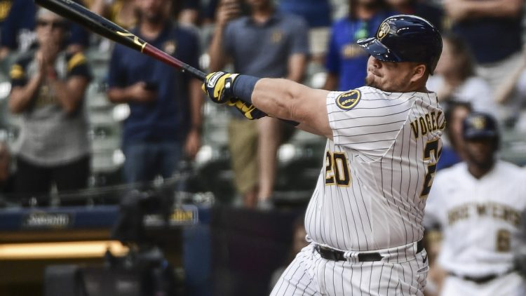 Sep 5, 2021; Milwaukee, Wisconsin, USA;  Milwaukee Brewers first baseman Daniel Vogelbach (20) hits a grand slam home run in the ninth inning to beat the St. Louis Cardinals at American Family Field. Mandatory Credit: Benny Sieu-USA TODAY Sports