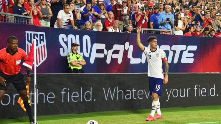 Sep 5, 2021; Nashville, Tennessee, USA; United States midfielder Christian Pulisic (10) on a corner kick in the first half against Canada during a CONCACAF FIFA World Cup Qualifier soccer match at Nissan Stadium. Mandatory Credit: Christopher Hanewinckel-USA TODAY Sports