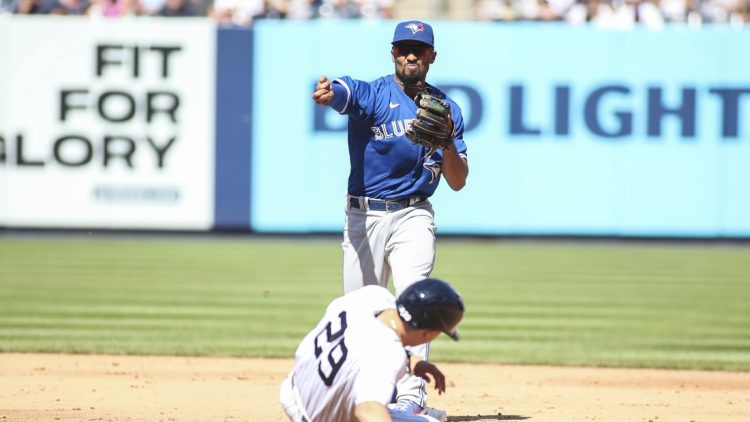 Sep 6, 2021; Bronx, New York, USA;  Toronto Blue Jays second baseman Marcus Semien (10) throws to first to complete a double play in the sixth inning against the New York Yankees at Yankee Stadium. Mandatory Credit: Wendell Cruz-USA TODAY Sports