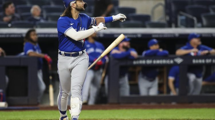 Sep 9, 2021; Bronx, New York, USA; Toronto Blue Jays shortstop Bo Bichette (11) flips his bat after hitting a leadoff solo home run against the New York Yankees in the first inning at Yankee Stadium. Mandatory Credit: Wendell Cruz-USA TODAY Sports