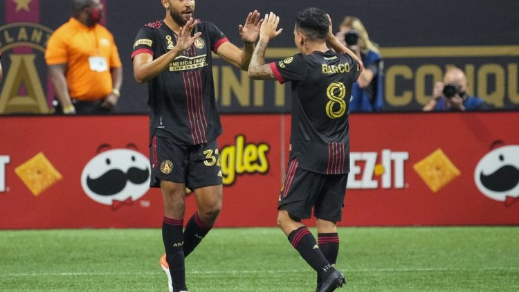 Sep 10, 2021; Atlanta, Georgia, USA; Atlanta United defender George Campbell (32) reacts with midfielder Ezequiel Barco (8) after scoring a goal against Orlando City during the first half at Mercedes-Benz Stadium. Mandatory Credit: Dale Zanine-USA TODAY Sports