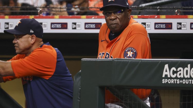 Sep 10, 2021; Houston, Texas, USA; Houston Astros manager Dusty Baker Jr. (12) looks on from the dugout during the fourth inning against the Los Angeles Angels at Minute Maid Park. Mandatory Credit: Troy Taormina-USA TODAY Sports