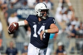 Sep 11, 2021; University Park, Pennsylvania, USA; Penn State Nittany Lions quarterback Sean Clifford (14) throws a pass during the first quarter against the Ball State Cardinals at Beaver Stadium. Mandatory Credit: Matthew OHaren-USA TODAY Sports