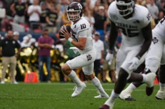 Sep 11, 2021; Denver, Colorado, USA; Texas A&M Aggies quarterback Zach Calzada (10) looks to pass in the second quarter against the Colorado Buffaloes  at Empower Field at Mile High. Mandatory Credit: Ron Chenoy-USA TODAY Sports
