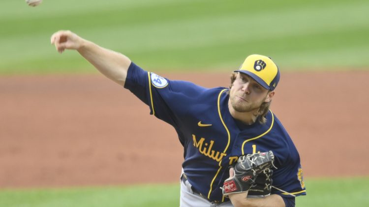 Sep 11, 2021; Cleveland, Ohio, USA; Milwaukee Brewers starting pitcher Corbin Burnes (39) delivers a pitch in the first inning against the Cleveland Indians at Progressive Field. Mandatory Credit: David Richard-USA TODAY Sports