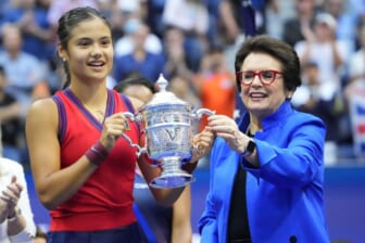 Sep 11, 2021; Flushing, NY, USA; Emma Raducanu of Great Britain (L) is presented the championship trophy by Billie Jean King (R) after her match against Leylah Fernandez of Canada (not pictured) in the women's singles final on day thirteen of the 2021 U.S. Open tennis tournament at USTA Billie Jean King National Tennis Center. Mandatory Credit: Robert Deutsch-USA TODAY Sports