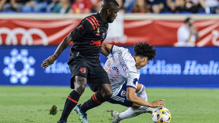 Sep 11, 2021; Harrison, New Jersey, USA; New York Red Bulls midfielder Dru Yearwood (16) battles for the ball against D.C. United midfielder Kevin Paredes (30) during the first half at Red Bull Arena. Mandatory Credit: Vincent Carchietta-USA TODAY Sports