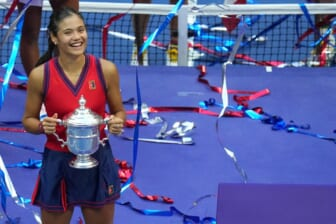 Sep 11, 2021; Flushing, NY, USA; Emma Raducanu of Great Britain celebrates with the championship trophy after her match against Leylah Fernandez of Canada (not pictured) in the women's singles final on day thirteen of the 2021 U.S. Open tennis tournament at USTA Billie Jean King National Tennis Center. Mandatory Credit: Danielle Parhizkaran-USA TODAY Sports