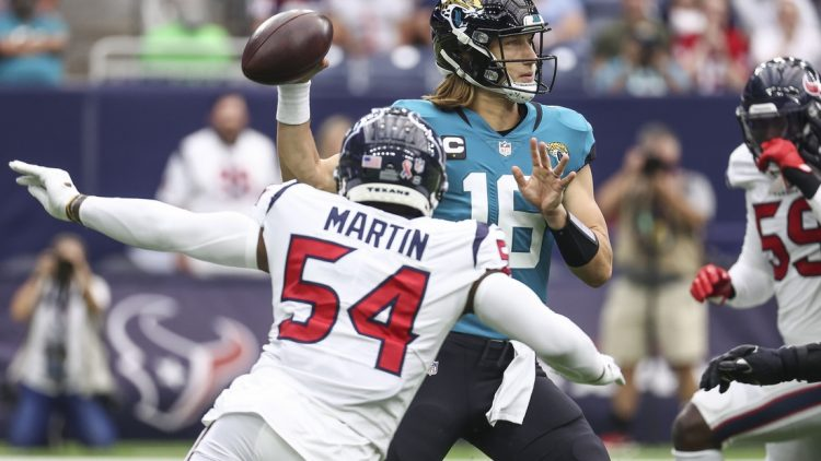 Sep 12, 2021; Houston, Texas, USA; Jacksonville Jaguars quarterback Trevor Lawrence (16) attempts a pass during the first quarter against the Houston Texans at NRG Stadium. Mandatory Credit: Troy Taormina-USA TODAY Sports