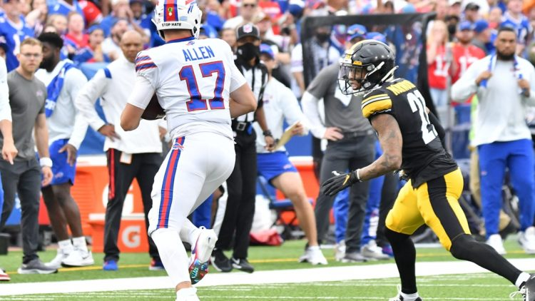 Sep 12, 2021; Orchard Park, New York, USA; Buffalo Bills quarterback Josh Allen (17) tries to outrun Pittsburgh Steelers cornerback Tre Norwood (21) in the first quarter of a game at Highmark Stadium. Mandatory Credit: Mark Konezny-USA TODAY Sports