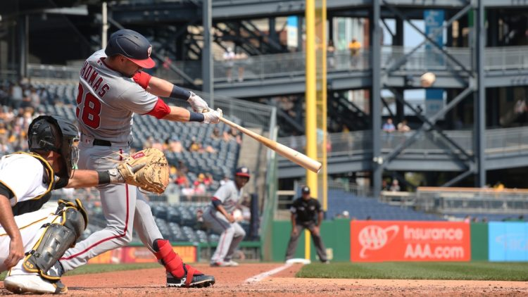 Sep 12, 2021; Pittsburgh, Pennsylvania, USA;  Washington Nationals center fielder Lane Thomas (28) hits a three run home run against the Pittsburgh Pirates during the fourth inning at PNC Park. Mandatory Credit: Charles LeClaire-USA TODAY Sports