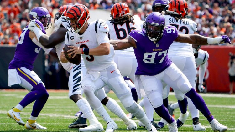 Cincinnati Bengals quarterback Joe Burrow (9) evades pressure by Minnesota Vikings defensive end Everson Griffen (97) in the second quarter during an NFL Week 1 football game, Sunday, Sept. 12, 2021, at Paul Brown Stadium in Cincinnati  Minnesota Vikings At Cincinnati Bengals Sept 12