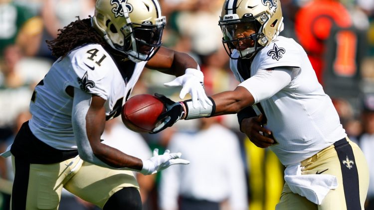 Sep 12, 2021; Jacksonville, Florida, USA;  New Orleans Saints quarterback Jameis Winston (2) hands off to  running back Alvin Kamara (41) in the first quarter against the Green Bay Packers at TIAA Bank Field. Mandatory Credit: Nathan Ray Seebeck-USA TODAY Sports