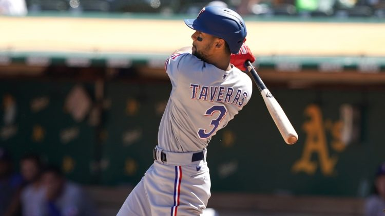 Sep 12, 2021; Oakland, California, USA; Texas Rangers center fielder Leody Taveras (3) hits an RBI triple during the fourth inning against the Oakland Athletics at RingCentral Coliseum. Mandatory Credit: Darren Yamashita-USA TODAY Sports