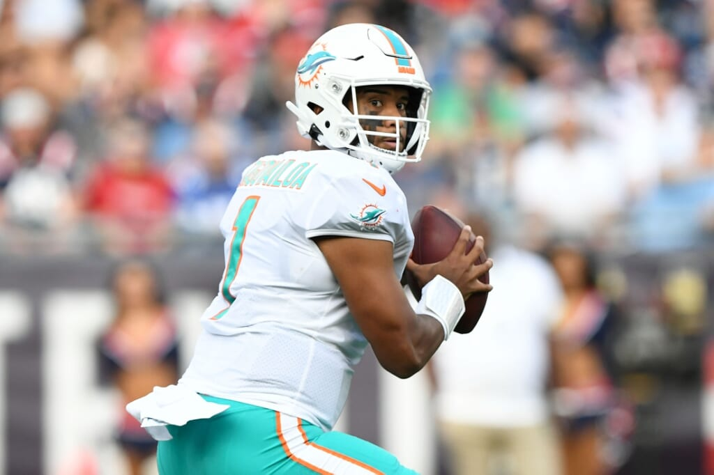 Sep 12, 2021; Foxborough, Massachusetts, USA; Miami Dolphins quarterback Tua Tagovailoa (1) looks to pass against the New England Patriots during the first half at Gillette Stadium. Mandatory Credit: Brian Fluharty-USA TODAY Sports