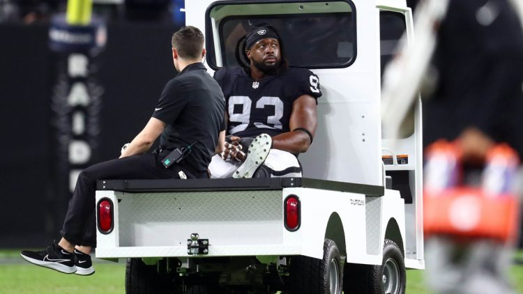Sep 13, 2021; Paradise, Nevada, USA; Las Vegas Raiders defensive tackle Gerald McCoy (93) is taken to the locker room after suffering an apparent injury during the second half at Allegiant Stadium. Mandatory Credit: Mark J. Rebilas-USA TODAY Sports