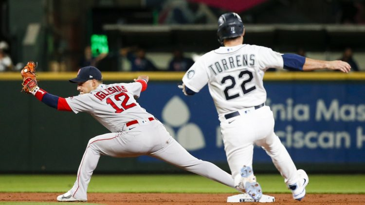 Sep 13, 2021; Seattle, Washington, USA; Boston Red Sox second baseman Jose Iglesias (12) reaches for a force out against the Seattle Mariners during the second inning at T-Mobile Park. Mandatory Credit: Joe Nicholson-USA TODAY Sports