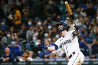 Sep 13, 2021; Seattle, Washington, USA; Seattle Mariners right fielder Mitch Haniger (17) hits a three-run home run against the Boston Red Sox during the seventh inning at T-Mobile Park. Mandatory Credit: Joe Nicholson-USA TODAY Sports