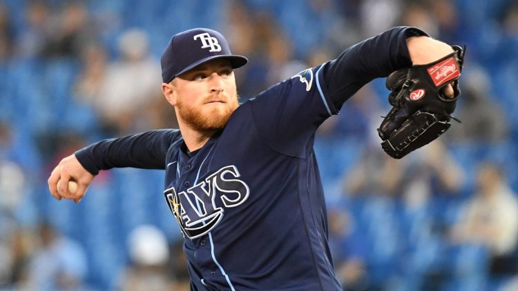 Sep 14, 2021; Toronto, Ontario, CAN; Tampa Bay Rays starting pitcher Drew Rasmussen (57) delivers against the Toronto Blue Jays in the first inning at Rogers Centre. Mandatory Credit: Dan Hamilton-USA TODAY Sports
