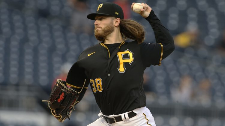 Sep 14, 2021; Pittsburgh, Pennsylvania, USA; Pittsburgh Pirates starting pitcher Dillon Peters (38) delivers against the Cincinnati Reds during the first inning at PNC Park. Mandatory Credit: Charles LeClaire-USA TODAY Sports