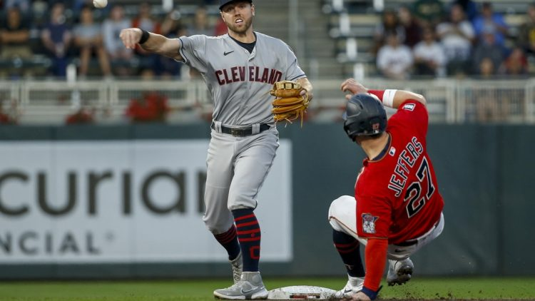 Sep 14, 2021; Minneapolis, Minnesota, USA; Cleveland Indians second baseman Owen Miller (6) forces out Minnesota Twins catcher Ryan Jeffers (27) and turns a double play in the second inning at Target Field. Mandatory Credit: Bruce Kluckhohn-USA TODAY Sports