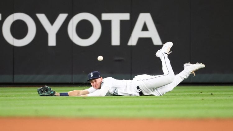 Sep 14, 2021; Seattle, Washington, USA;  Seattle Mariners center fielder Jarred Kelenic (10) is unable to make the catch for a hit off the bat of Boston Red Sox shortstop Jose Iglesias (12) in the fifth inning at T-Mobile Park. Mandatory Credit: Abbie Parr-USA TODAY Sports