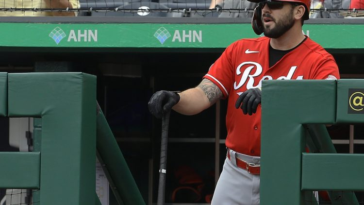 Sep 16, 2021; Pittsburgh, Pennsylvania, USA;  Cincinnati Reds third baseman Mike Moustakas (9) looks on from the dugout before batting against the Pittsburgh Pirates during the first inning at PNC Park. Mandatory Credit: Charles LeClaire-USA TODAY Sports