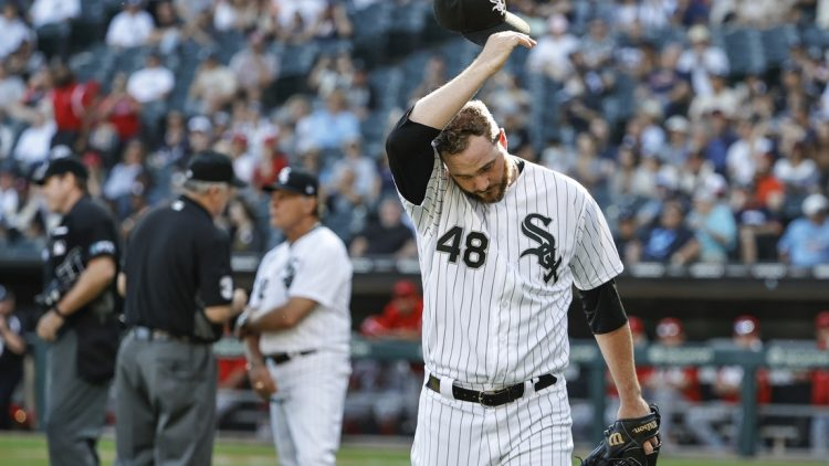 Sep 16, 2021; Chicago, Illinois, USA; Chicago White Sox relief pitcher Mike Wright Jr. (48) leaves a baseball game against the Los Angeles Angels after umpire Bill Welke (3) throws him out during the ninth inning at Guaranteed Rate Field. Mandatory Credit: Kamil Krzaczynski-USA TODAY Sports